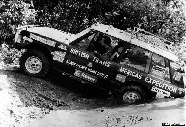 Landrover being driven out of water in jungle