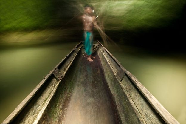 Embera man on boat on Mogue river in the Darien province