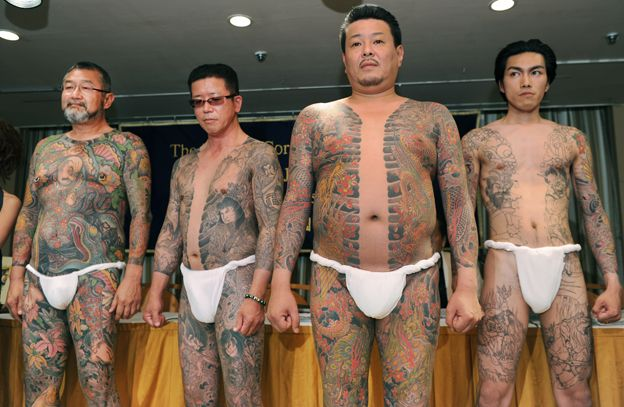 Male models show off their full body tattoos in the style of Yakuza