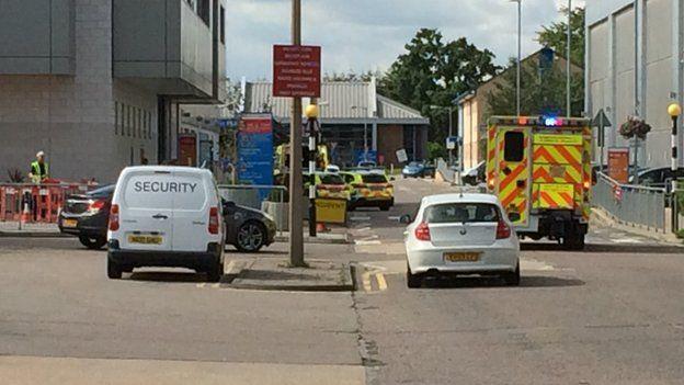 Still of police outside Basildon Hospital on August 16