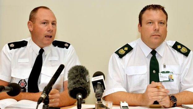 Superintendent Trevor Roe from Essex Police and Daniel Gore of the East of England Ambulance service, during a press conference close to Tilbury Docks in Essex