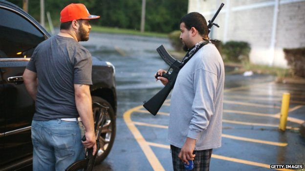 Business owners carry assault weapons to protect their stores from looters in Ferguson, Missouri - 16 August 2014