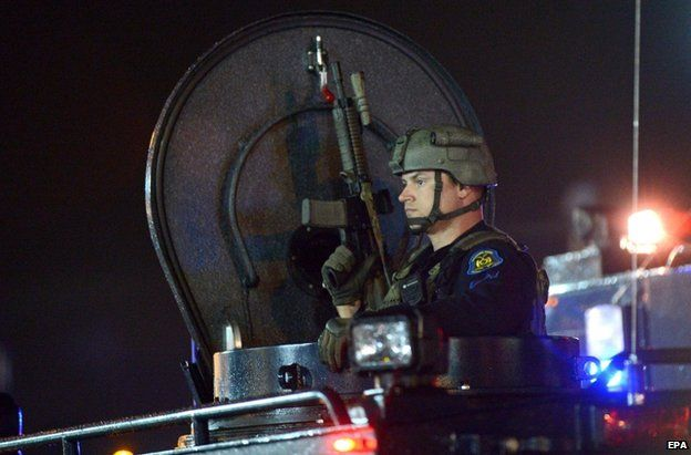 Police in Ferguson, St Louis, late on 16 August