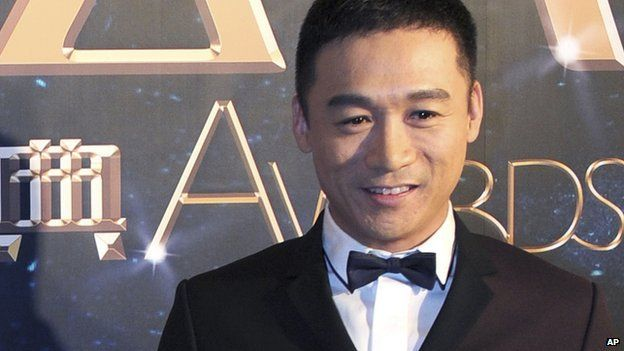 In this photo taken on Tuesday, 18 March, 2014, actor Gao Hu poses on the red carpet during the award ceremony of the Celebrity Citizens in Beijing, China