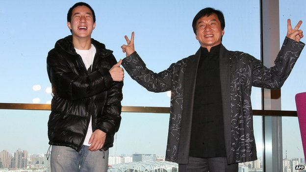 Hong Kong entertainer Jackie Chan (R) poses with his son Jaycee Fong Jo Ming as they take part in a press conference for Chan's concert at Beijing's Bird's Nest stadium, the centrepiece of the 2008 Olympic Games, in Beijing on 1 April, 2009