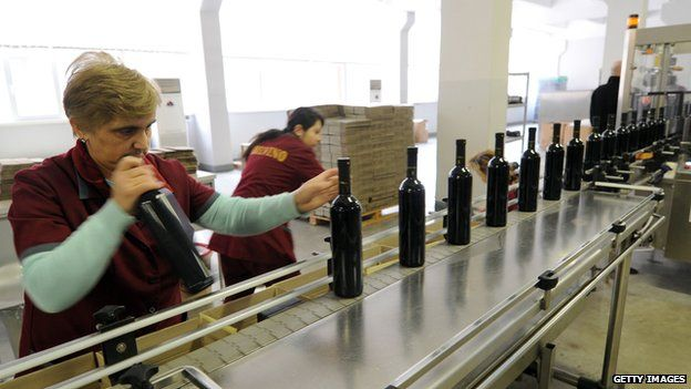Wine being bottled and packaged at a winery in Tbilisi