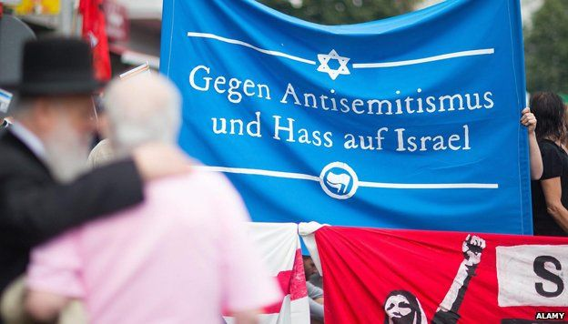 Pro Israel activists hold a banner reading 'Against Anti-Semitism and hate of Israel' at a demonstration as part of Quds Day in Berlin, Germany, 25 July 2014