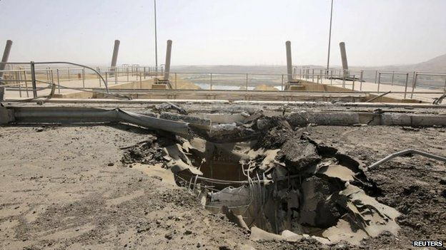 A crater seen at the entrance of Mosul Dam, 21 August 2014