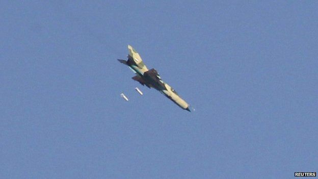 A warplane operated by forces of Syria's President Bashar Al-Assad carries out what activists said was an air raid around al-Tabqa military base at a government-controlled airport that is surrounded by militants, west of Raqqa city, August 21, 2014