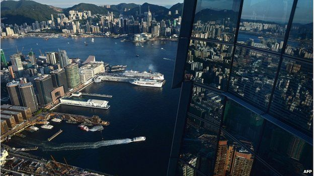 This picture taken on 23 August 2014 shows a general view of commercial and residential buildings near Hong Kong's Victoria harbour.