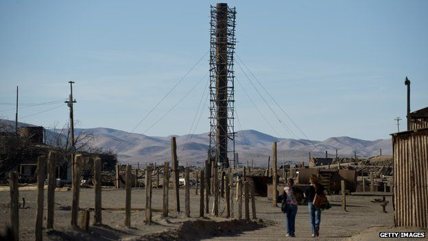 Tourists visit the ex Humberstone saltpeter, near Pozo Almonte in the Atacama Desert in the Tarapaca Region some 800 km north of the Chilean capital, Santiago, on 14 November, 2012.