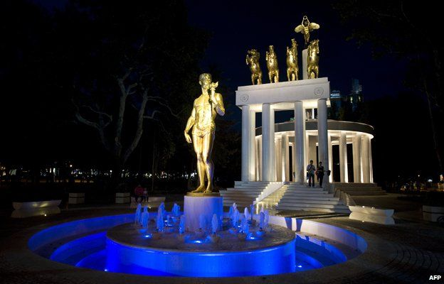Golden statue by night