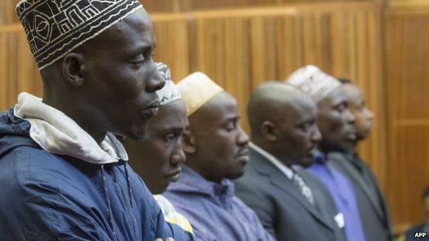 Sady Abdou, Hemedi Dendengo Sefu, Amani Uriwane, Richard Bachisa, Hassann Nduli and Pascal Kanyandekwe, six men accused of the attempted assassination of General Nyamwasa, former Rwanda chief of staff, listen on 28 August 2014 on the first day of their sentencing at the Kagiso Magistrate Court in Krugersdorp, South Africa