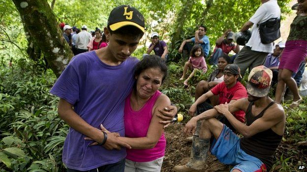 Margarita Mendez hugs her son while she waits for news of her other son, one of the miners trapped at the mine in Nicaragua - 29 August 2014