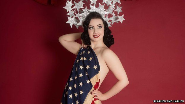 Eliza DeLite draped in a Stars and Stripes flag