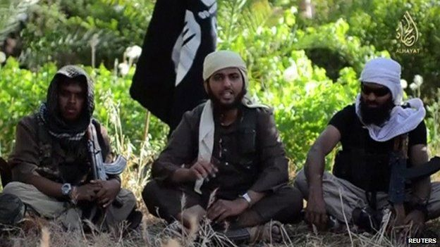 A video screengrab of three Islamic militants sitting on the ground speaking to the camera