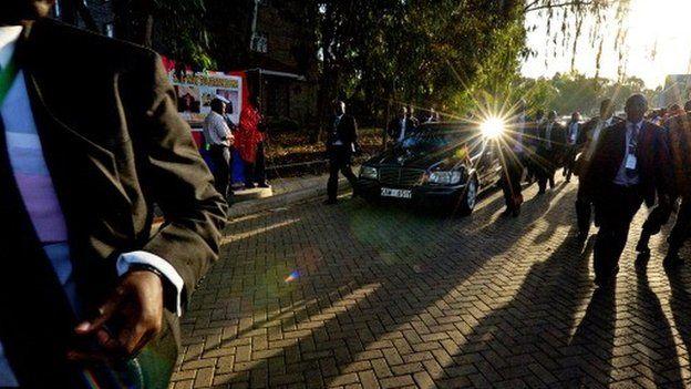 Kenyan presidential security escort President Uhuru Kenyatta's car - March 2013