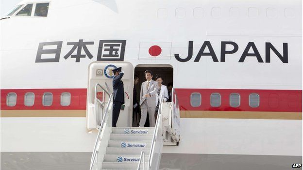 Japanese Prime Minister Shinzo Abe prepares to get off his plane upon his arrival in Port of Spain, Trinidad and Tobago on 27 July 2014.