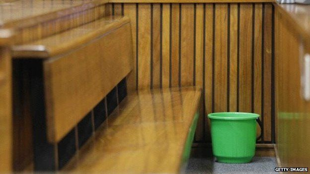 An empty bucket is seen where Oscar Pistorius normally sits in the Pretoria High Court on 8 April 2014, in Pretoria, South Africa