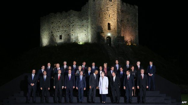 World leaders participate in an official family photograph ahead of a Nato summit leaders' dinner at Cardiff Castle (4 September 2014)