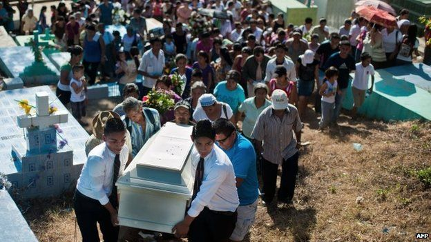 Citizens and relatives of 18-year-old Noe Enrique Bonilla, who was allegedly murdered by gang members, participate in his funeral in the town of San Jose Villanueva, 25 km south of San Salvador, 25 July 2014
