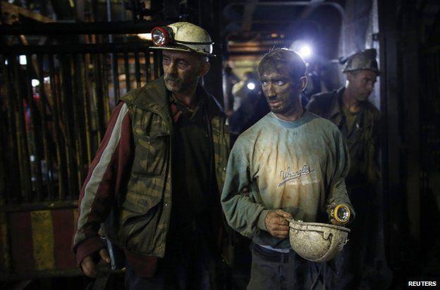Surviving miners leave the Raspotocje coal mine in Zenica, 5 September