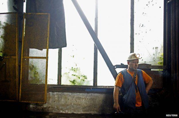 A miner stands outside the Raspotocje coal mine in Zenica, 5 September