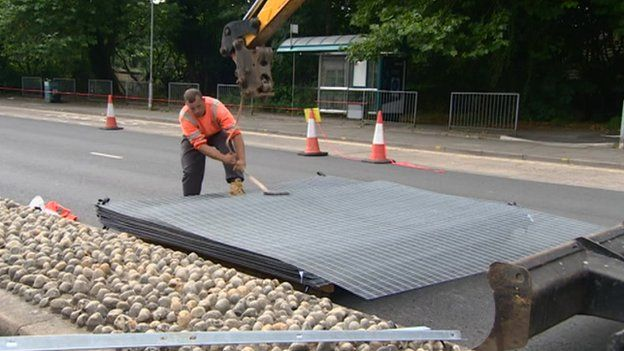 Workers removing security barriers in Cardiff