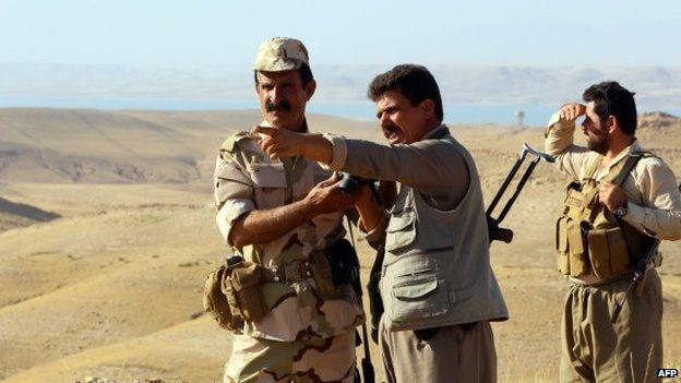 Iraqi Peshmerga fighters gesture as they take position at a post near the jihadist-held city of Zumar in Mosul province on 4 September 2014