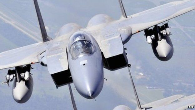 In this July 11, 2009, image obtained from the US Navy, Two F-15 Strike Eagles assigned to the Louisiana Air National Guard 159th Fighter Wing fly over southern Louisiana's wetlands during a photo exercise