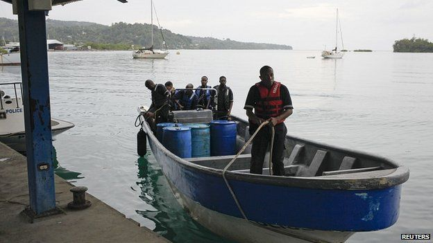 Jamaica's marine police return to port after leaving the site where a small private plane is presumed to have crashed. 5 Sept 2014