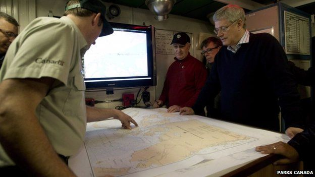 Canadian Prime Minister Stephen Harper is briefed on the ship's location