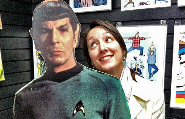 Sonia stands next to a cardboard figure of Spock