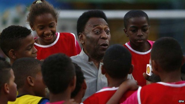 Pele with young footballers
