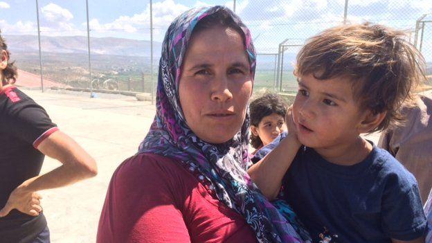 Heyfek Neus with a child