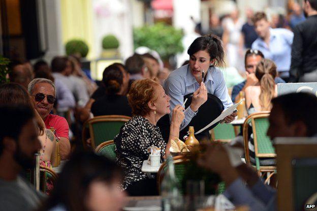 Waitress serves table