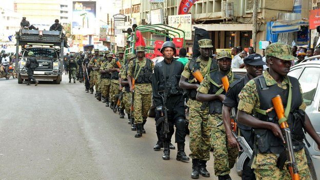 UPDF soldiers and police forces patrol streets in Kampala with a tactical operation vehicle on 3 July 2014