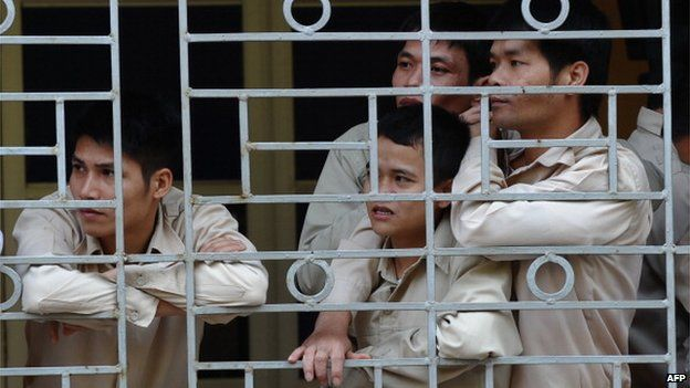 This picture taken on 29 November 2013 shows drug addict inmates watching a music concert named 'Bringing music into hospitals' organised by a group of local artists to mark the World Aids Day at an official centre for treatment of drug addicts in Hanoi.
