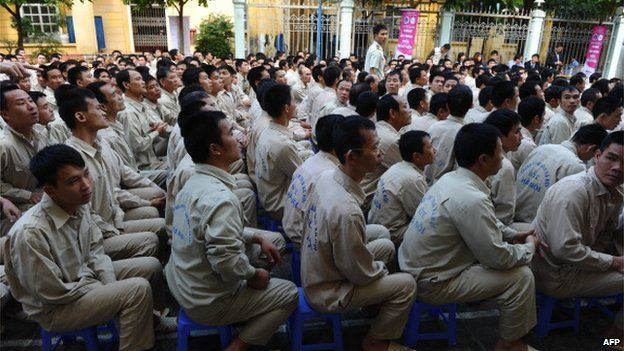 This picture taken on 29 November 2013 shows drug addict inmates waiting for the start of a music concert named 'Bringing music into hospitals' organised by a group of local artists to mark the World Aids Day at an official centre for treatment of drug addicts in Hanoi.