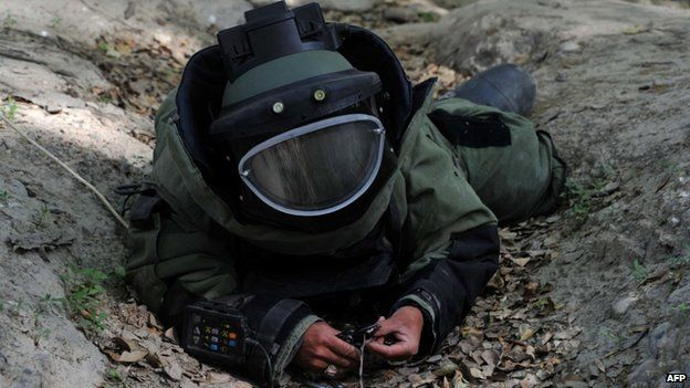 Afghan National Army soldier participates in an IED defusing training exercise in Jalalabad, Nangarhar province
