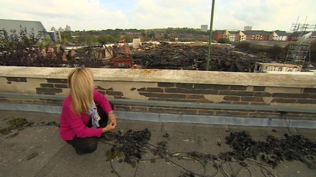 East Midlands Today reporter Jo Healey on a nearby roof