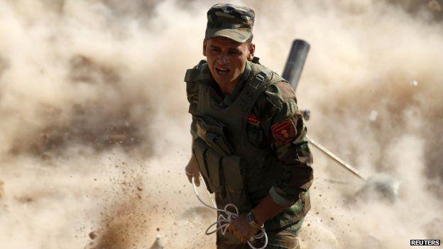 A Kurdish Peshmerga fighter launches mortar shells near Mosul. Photo: 15 September 2014