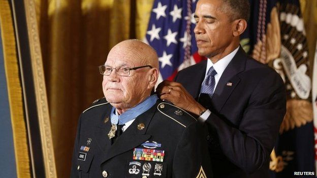 US President Barack Obama awards the Medal of Honor to Army Command Sergeant Major Bennie G. Adkins for actions during the Vietnam War while in the East Room of the White House in Washington, 15 September 2014