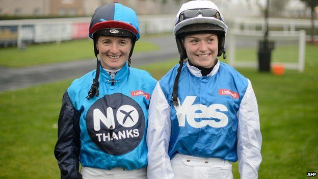 """Jockey Carol Batley, representing the """"No"""" vote, (L) and jockey Rachael Grant, representing the """"Yes"""" vote, prepare to take part in a """"Referendum Race"""" sponsored by Ladbrokes at Musselburgh racecourse on September 15, 2014"""