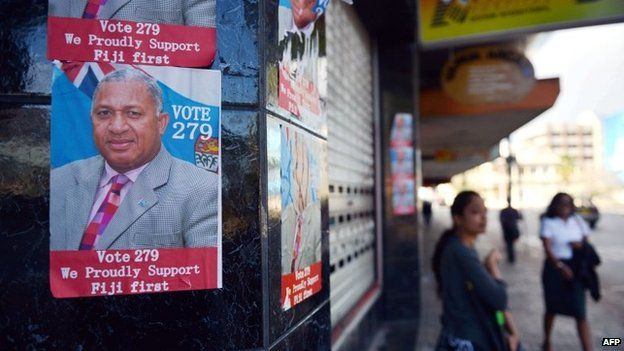 An election poster of Fiji's military strongman Voreqe Bainimarama is seen in Suva, the capital of Fiji, on 15 September 2014