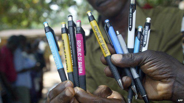 Biafran activists hold pens embossed with Biafran logos 19 August 2005 in Okwe in south-eastern Nigeria