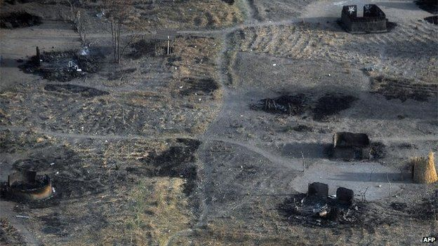 A photo taken on 21 February 2014 shows a compound with burnt tukuls (huts) at a village in Panyijiar county, Unity state, South Sudan