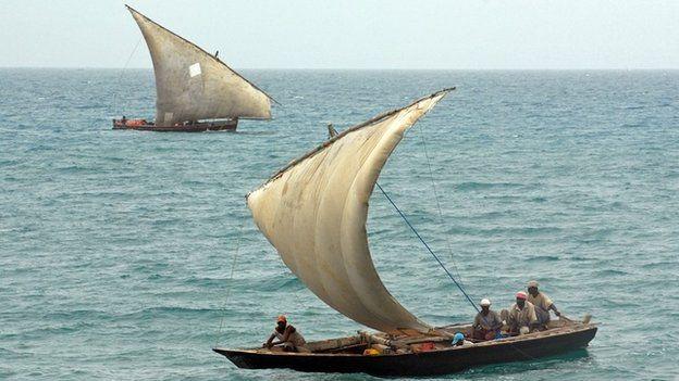 Dhows sailing off the shoreline of Zanzibar, Tanzania (archive)