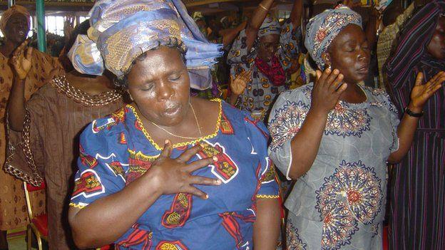 Nigerian women pray in undated picture.