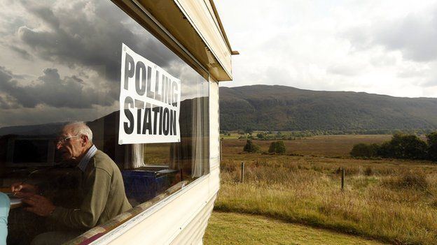 Poll clerk George MacKay sits in the Coulags caravan polling station, in the Scottish Highlands